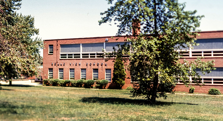 Color photograph of Belle View Elementary School from a 35 millimeter slide. The photograph shows the side of the building that faces Fort Hunt Road. The picture was taken in the late 1970s or early 1980s.